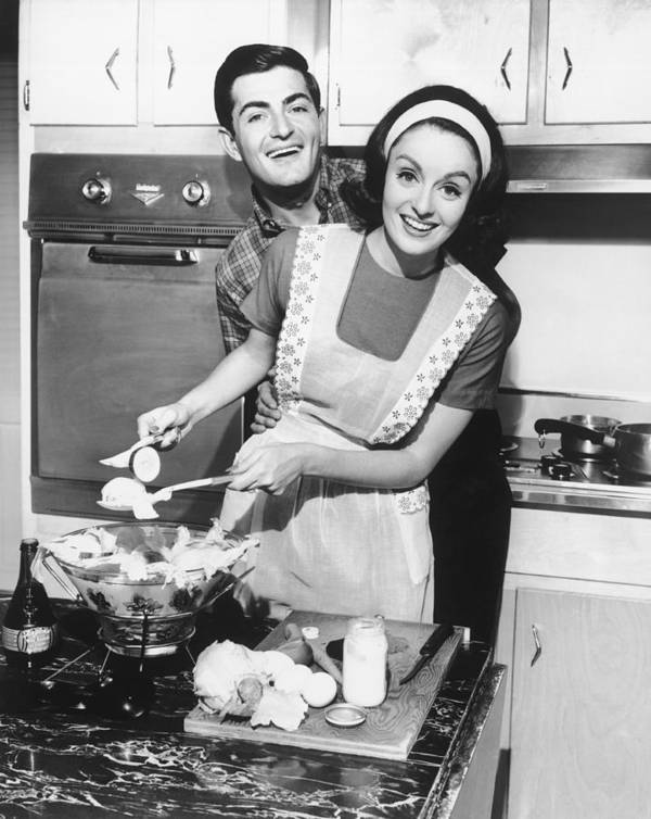 30-34 Years Art Print featuring the photograph Couple Standing In Kitchen, Smiling, (b&w) by George Marks