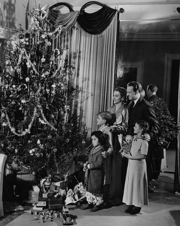 4-5 Years Art Print featuring the photograph Family With Three Children (4-9) Standing At Christmas Tree, (b&w) by George Marks
