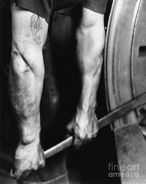 Railroad; Rail; Railway; Worker; Work; Labour; Working; Labourer; Male; Detail; Tight; Tightening; Security; Safety; Building; Construction; Wheel; Arm; Arms; Strong; Strength; Muscular; Tattoo; Body Art; Black And White Photograph; B/w Photo; Masculine; Power; Muscles; Metal; Challenge; Achievement; Effort; 1930s; 30s; Thirties; Travel; Transport; 1920s; 20s; Twenties; Lever; Pulling; Strain Art Print featuring the photograph Railroad Worker Tightening Wheel by LW Hine