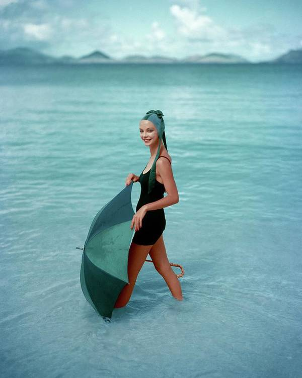 Fashion Art Print featuring the photograph A Model In The Sea With An Umbrella by Richard Rutledge