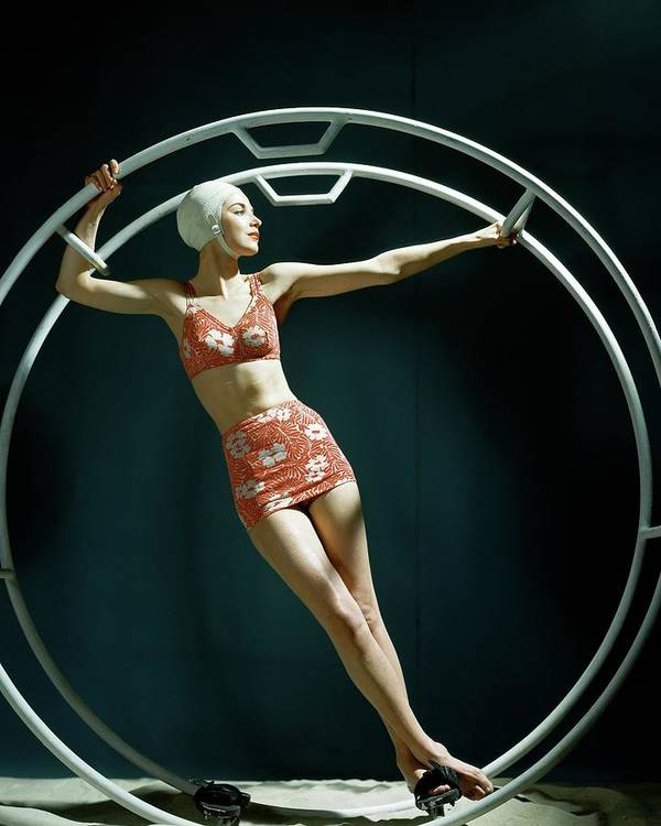 Swimwear Art Print featuring the photograph A Model Wearing A Swimsuit In An Exercise Ring by John Rawlings