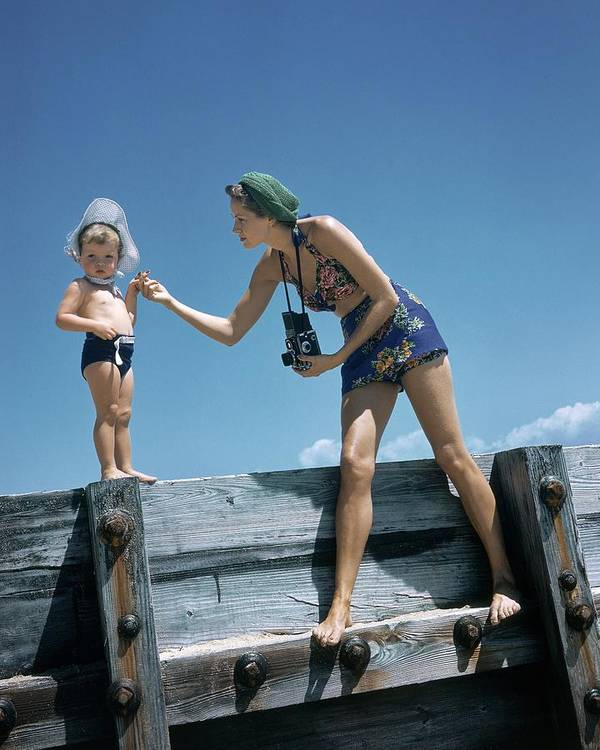 Children Art Print featuring the photograph A Mother And Son On A Pier by Toni Frissell