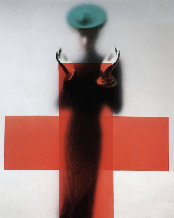 Fashion Art Print featuring the photograph A Woman Standing Behind A Red Cross On Frosted by Erwin Blumenfeld