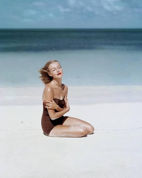 Fashion Art Print featuring the photograph Liz Benn Sitting On A Beach by John Rawlings
