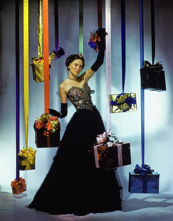Accessories Art Print featuring the photograph Model Wearing An Evening Gown Among Gifts by John Rawlings