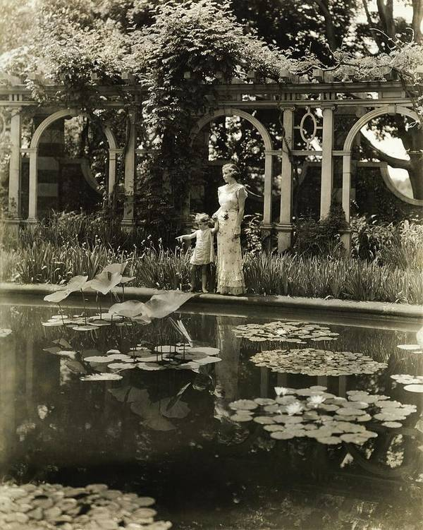 Children Art Print featuring the photograph Mother And Daughter By A Pond by Toni Frissell