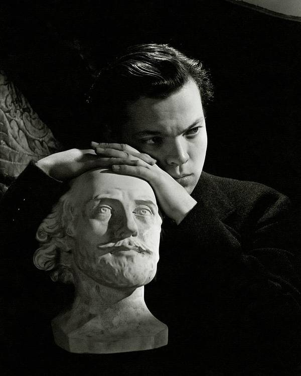 Artist Art Print featuring the photograph Orson Welles Resting On A Sculpture by Cecil Beaton