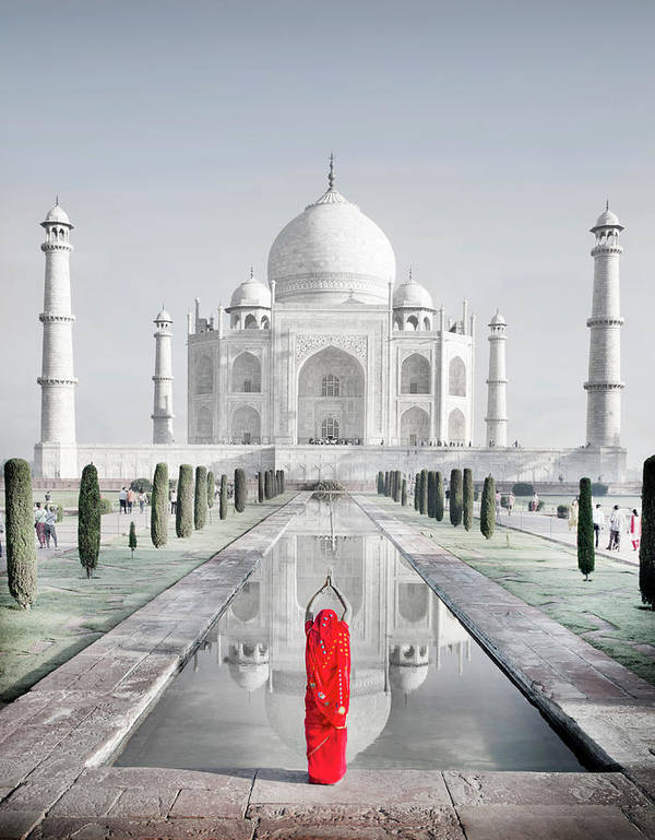Tranquility Art Print featuring the photograph Woman In Red Sari Praying At Taj Mahal by Grant Faint