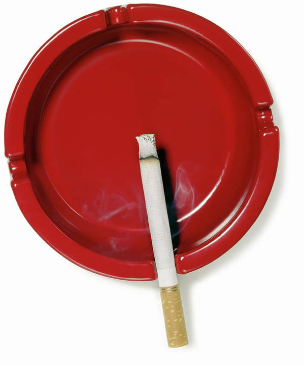 White Background Art Print featuring the photograph A Red Ashtray With A Burning Cigarette by Steve Wisbauer