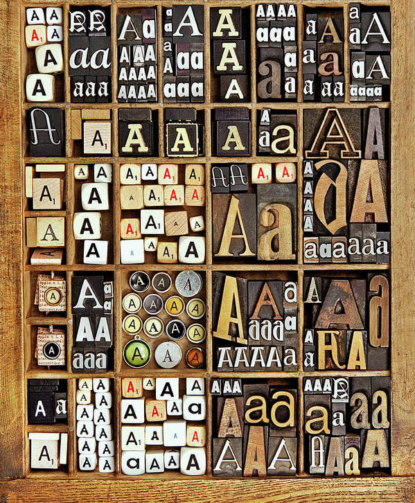 In A Row Art Print featuring the photograph Alphabet by Daryl Benson