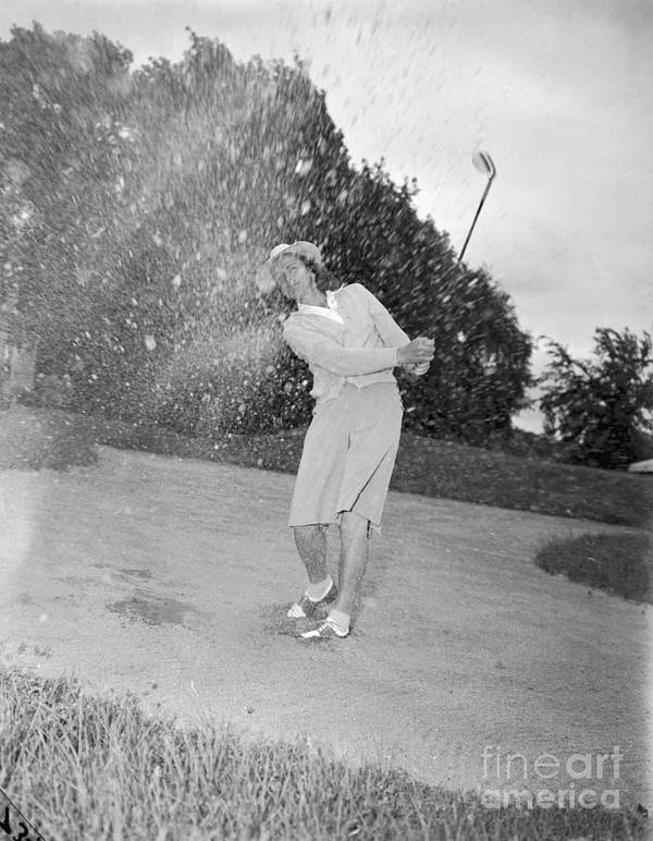 Sand Trap Art Print featuring the photograph Babe Didrikson Spraying Sand With Golf by Bettmann