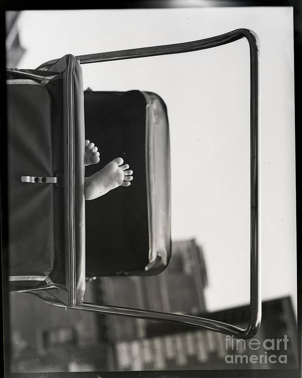 Child Art Print featuring the photograph Babys Feet Peeking Out Of Carriage by Bettmann