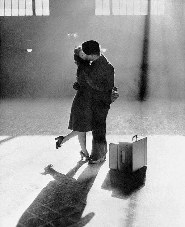 Shadow Art Print featuring the photograph Couple Kissing In Train Station by Bettmann
