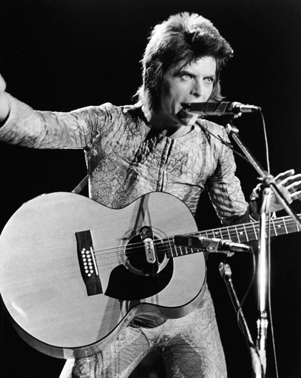 Ziggy Stardust - Persona Art Print featuring the photograph David Bowie Performing As Ziggy Stardust by Hulton Archive