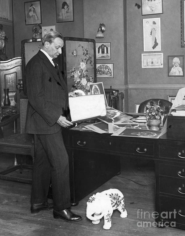 People Art Print featuring the photograph Florenz Ziegfeld Looking At Photographs by Bettmann