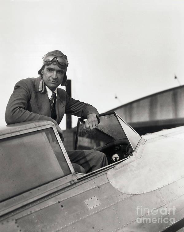 Biker Gang Art Print featuring the photograph Howard Hughes Posing In Plane Cockpit by Bettmann