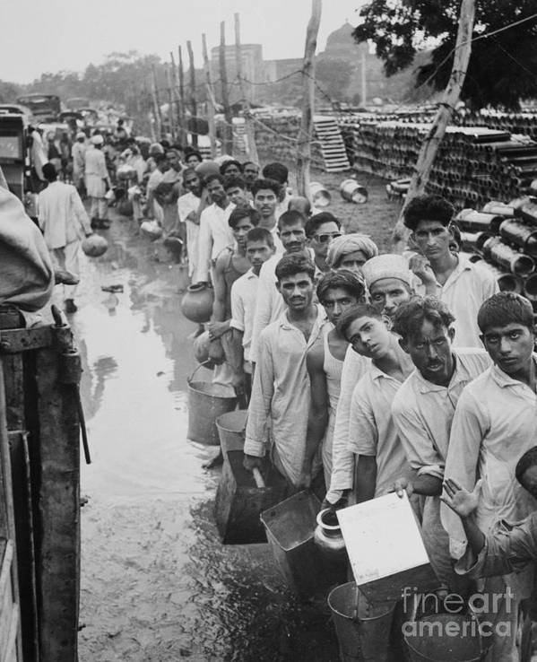 New Delhi Art Print featuring the photograph Indian Refugees Waiting For Water by Bettmann