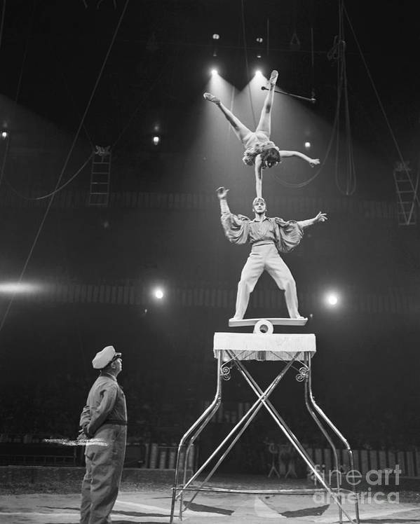 Mid Adult Women Art Print featuring the photograph Italian Circus Performers Balancing by Bettmann