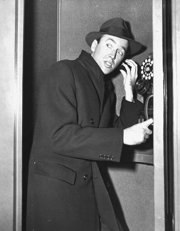 Jimmy Stewart Art Print featuring the photograph James Stewart Stops To Make A Call At by New York Daily News Archive