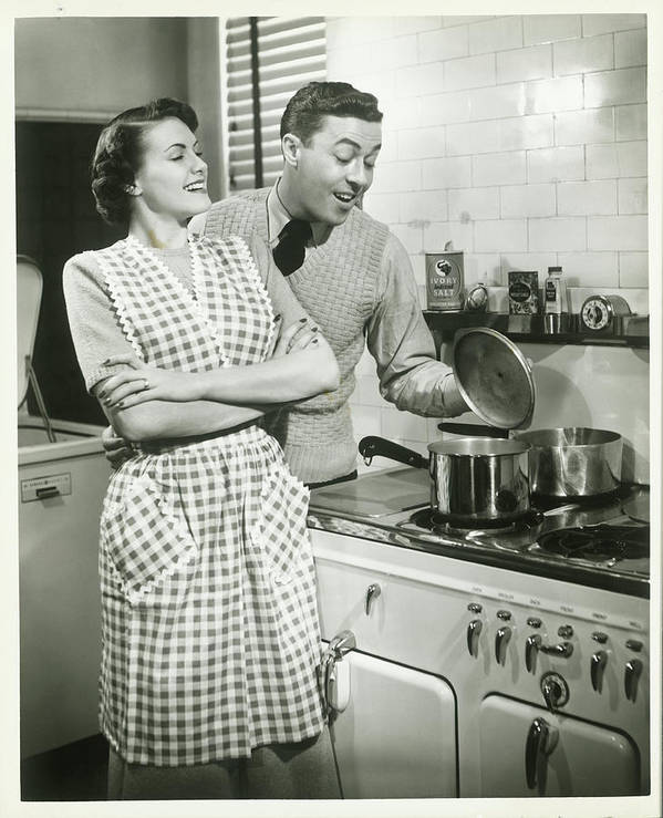 Heterosexual Couple Art Print featuring the photograph Man Looking Into Pot In Domestic by George Marks