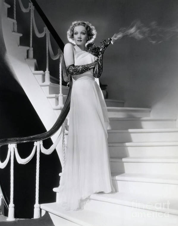Smoking Art Print featuring the photograph Marlene Dietrich Smoking On Staircase by Bettmann