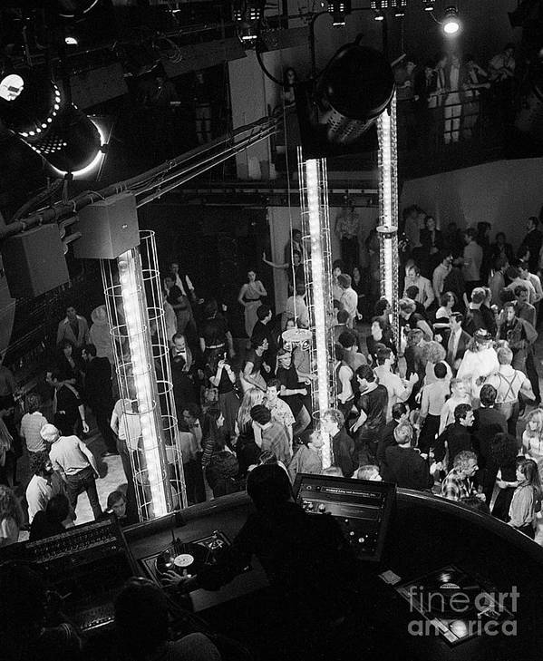 Crowd Of People Art Print featuring the photograph People Dancing At Studio 54 by Bettmann