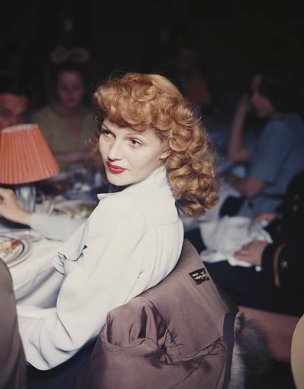Looking Over Shoulder Art Print featuring the photograph Rita Eats Out by Hulton Archive