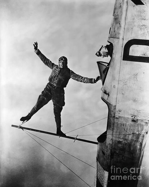 Aerobatics Art Print featuring the photograph Stunt Flier Suspended Over Cockpit by Bettmann