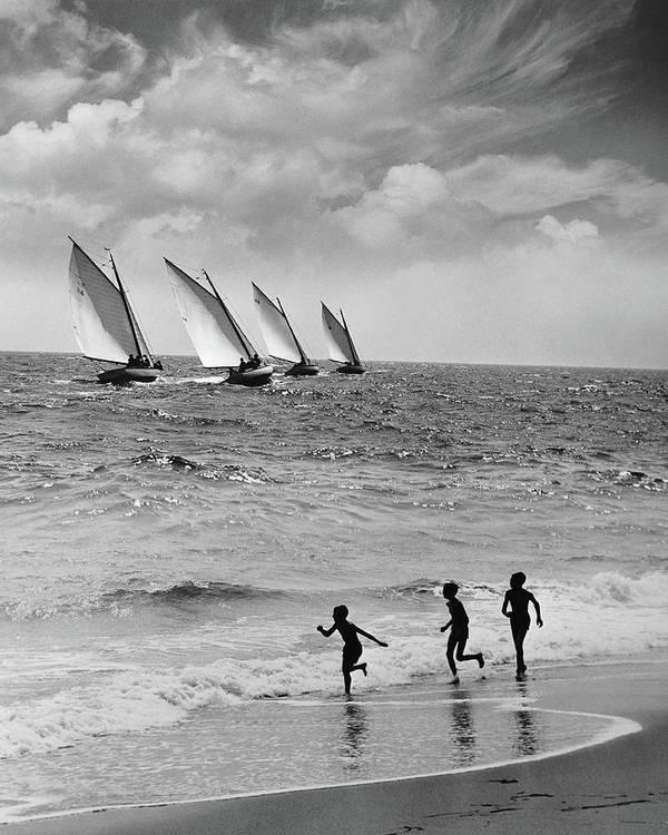 Following Art Print featuring the photograph Three Boys Running Along Beach by Stockbyte