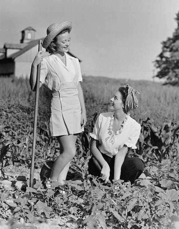 People Art Print featuring the photograph Two Women Gardening In Field by George Marks