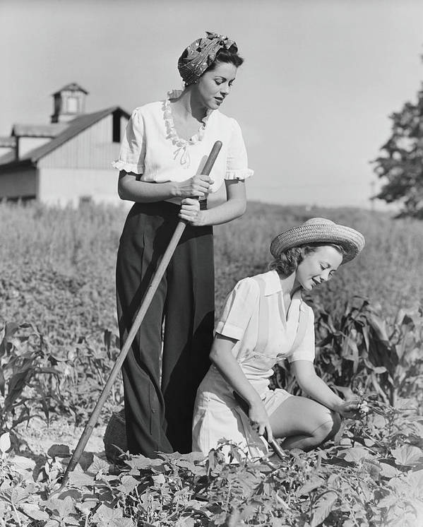 Straw Hat Art Print featuring the photograph Two Women Working On Field, B&w by George Marks