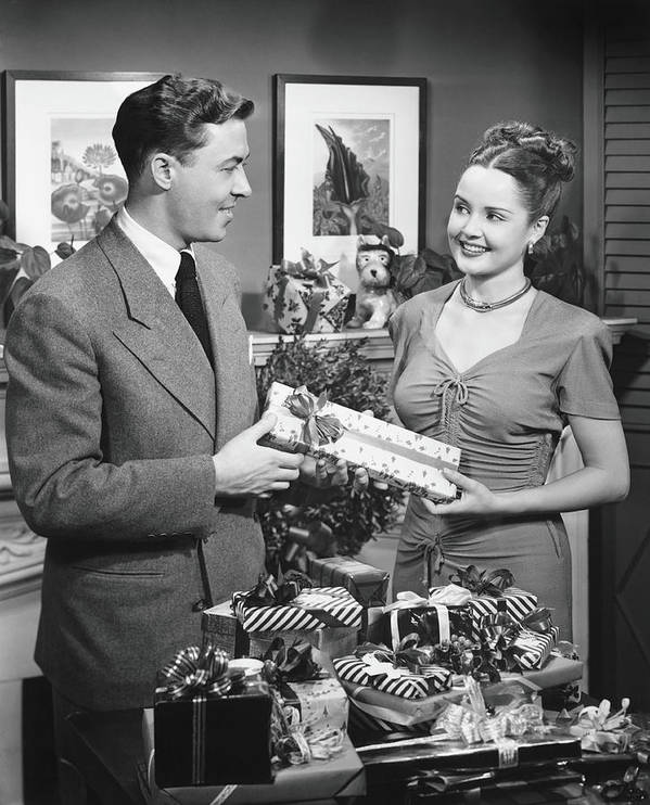 Heterosexual Couple Art Print featuring the photograph Woman Giving Gift To Man, B&w by George Marks