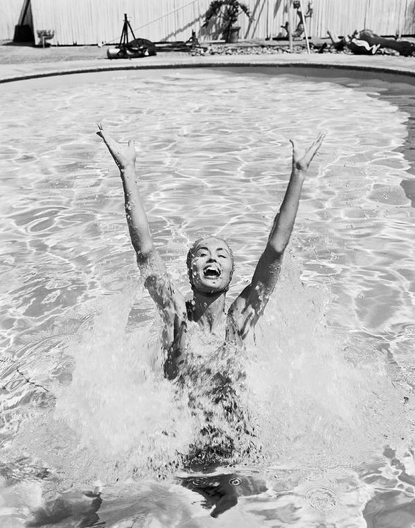 Human Arm Art Print featuring the photograph Woman Having Fun In Swimming Pool by Tom Kelley Archive