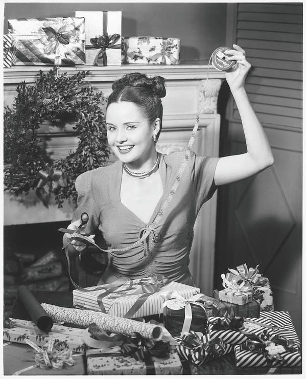 Human Arm Art Print featuring the photograph Woman Wrapping Christmas Presents In by George Marks