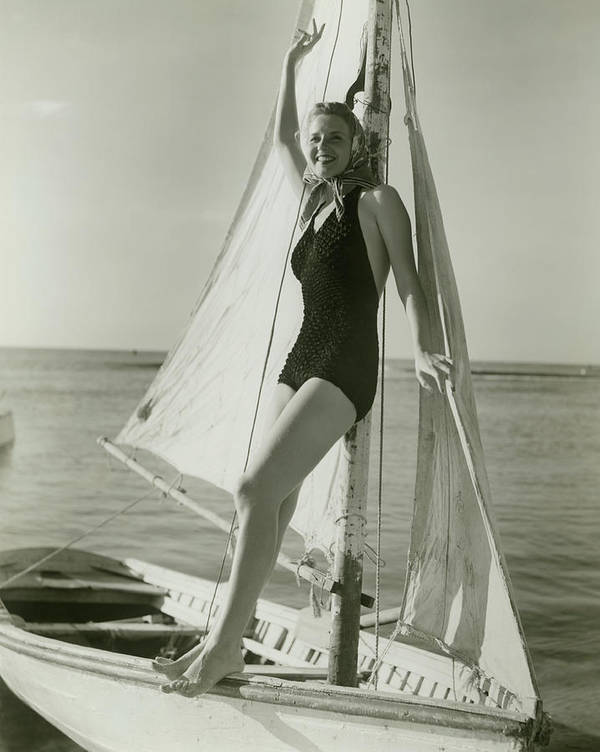 Human Arm Art Print featuring the photograph Young Woman Posing On Sailboat by George Marks