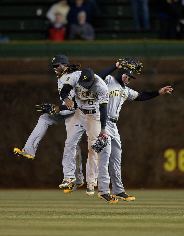 Celebration Art Print featuring the photograph Andrew Mccutchen, Starling Marte, and Travis Snider by Brian Kersey