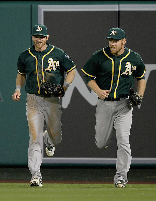 American League Baseball Art Print featuring the photograph Derek Norris, Howie Kendrick, and Brandon Moss by Harry How