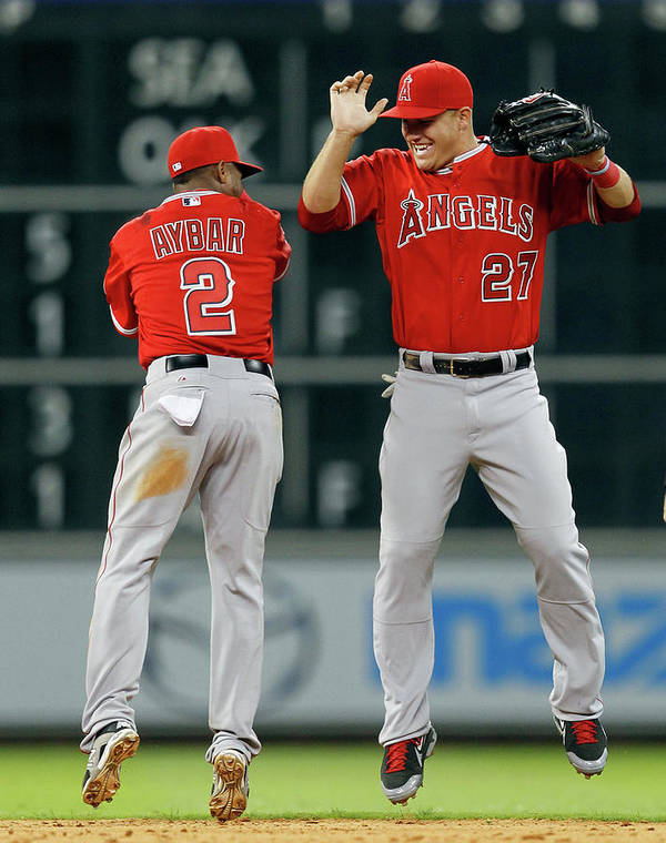 American League Baseball Art Print featuring the photograph Erick Aybar And Mike Trout by Bob Levey