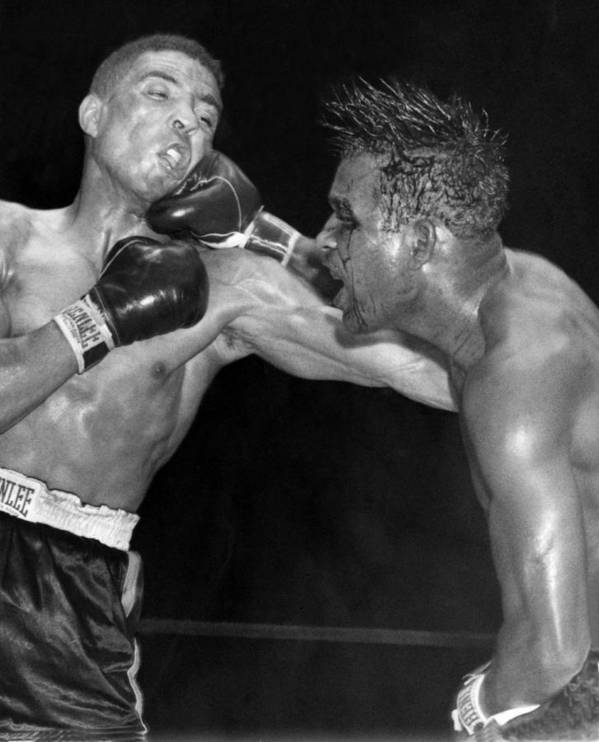 1951 Print featuring the photograph Sugar Ray Throws A Right by Underwood Archives
