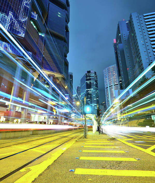 Vertical Art Print featuring the photograph Traffic Trails In City by Leung Cho Pan