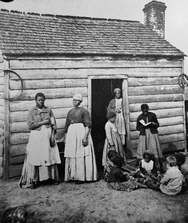 Child Art Print featuring the photograph Presumed Slaves And Their Shack by Hulton Archive