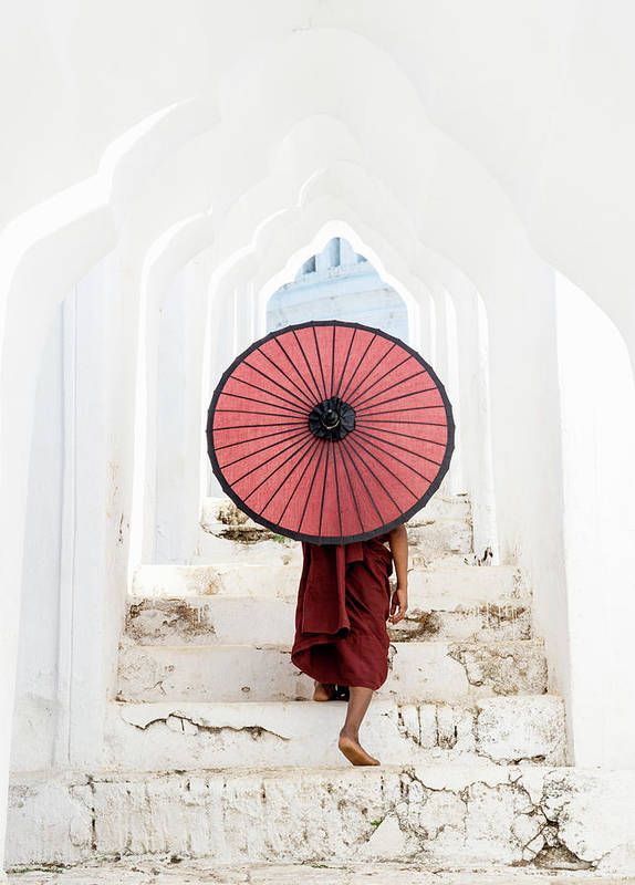 Steps Art Print featuring the photograph Buddhist Monk Walking Along Temple by Martin Puddy