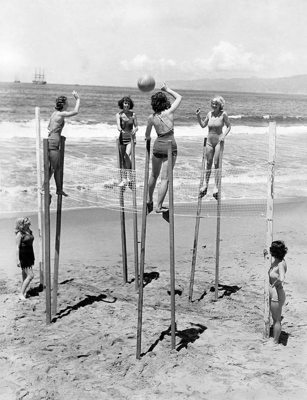 1930's Art Print featuring the photograph Volleyball On Stilts by Underwood Archives