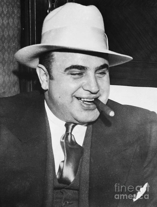 Al Capone Art Print featuring the photograph Gangster Al Capone Smoking Cigar by Bettmann