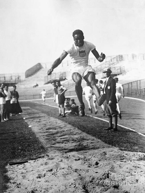 The Olympic Games Art Print featuring the photograph American Hubbard Wins Olympic Long Jump by Bettmann
