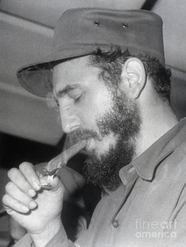 Smoking Art Print featuring the photograph Fidel Castro Lighting A Cigar by Bettmann