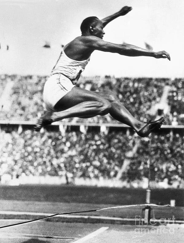 The Olympic Games Art Print featuring the photograph Jesse Owens In Midair by Bettmann