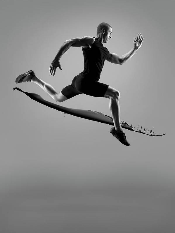 People Art Print featuring the photograph Male Athlete Running Above Liquid Splash by Jonathan Knowles
