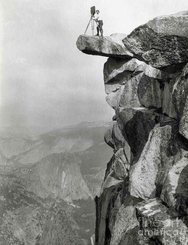 People Art Print featuring the photograph Photographer Standing On Mountain Ledge by Bettmann