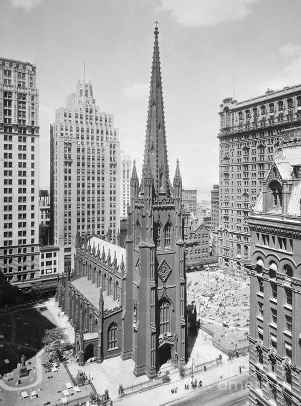 1930-1939 Art Print featuring the photograph Trinity Church On Wall Street by Bettmann